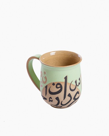 Jug shaped emerald mug
